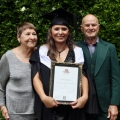 LC_with_her_parents_graduation